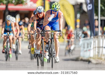 STOCKHOLM - AUG 22, 2015: Lotte Miller (NOR) drinking water in front at the Womens ITU World Triathlon series event in Stockholm.