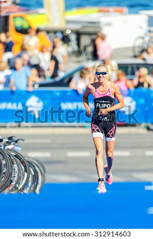STOCKHOLM - AUG 22, 2015: Michelle Flipo (ITU) running on blue mat at the Womens ITU World Triathlon series event in Stockholm.
