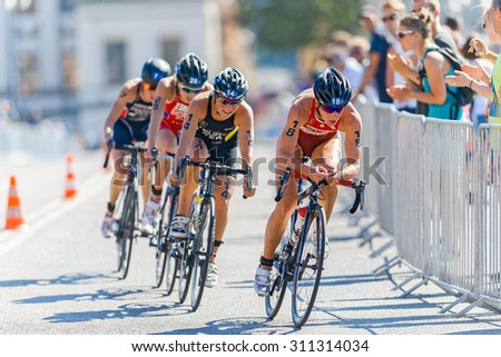 STOCKHOLM - AUG 22, 2015: Nicola Spirig (SUI) leading a cycling group at the Womens ITU World Triathlon series event in Stockholm. - stock photo