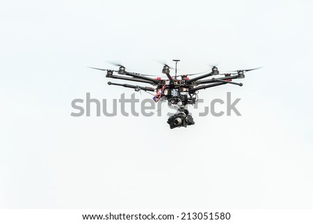 STOCKHOLM - AUG, 23: Professional hexacopter drone for live television at Mens ITU World Triathlon Series event August 23, 2014 in Stockholm, Sweden. - stock photo