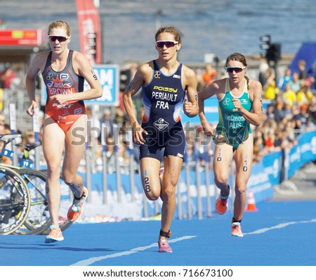 STOCKHOLM - AUG 26, 2017: Triathlete Brown, Periault and Van Coevorden running in the transition zone in Stockholm in the Women's ITU World Triathlon series event August 26, 2017 in Stockholm, Sweden