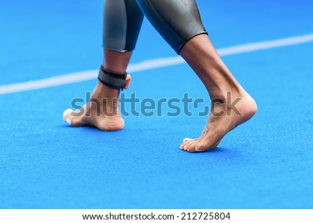 STOCKHOLM - AUG, 23: Triathlete feet passing by at the Mens ITU World Triathlon Series event Aug 23, 2014 in Stockholm, Sweden - stock photo