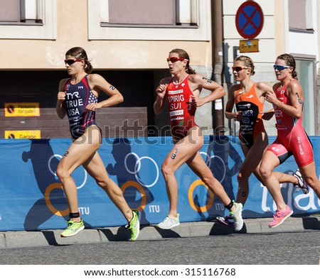 STOCKHOLM - AUG 22, 2015: Triathlete Sarah True running, followed by Nicola Spirig, Rachel Klamer and Flora Duffy in the Women's ITU World Triathlon series event August 22, 2015 in Stockholm, Sweden - stock photo
