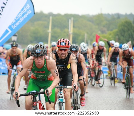 STOCKHOLM - AUG 23: Triathletes Conor Murphy(IRL) and Gregor Buchholz(GER) cycling in the Men's ITU World Triathlon series event Aug 23, 2014 in Stockholm, Sweden - stock photo