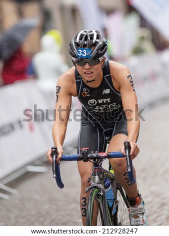 STOCKHOLM - AUG, 23:  World Triathlon  event Aug 23, 2014. woman running in Old town, Stockholm, Sweden. Yurie Kato, JAP.