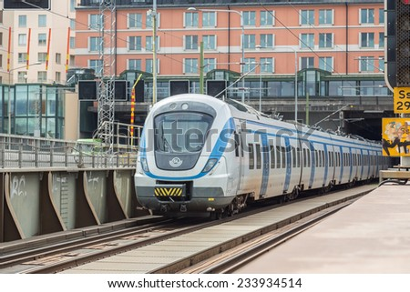 STOCKHOLM - AUGUST 05: Metro train on August 5, 2014 in Stockholm, Sweden. Metro trains are currently the most environmentally friendly option to travel within the city.