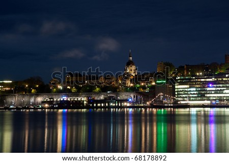 Stockholm cityscape at night with light reflection in water - stock photo