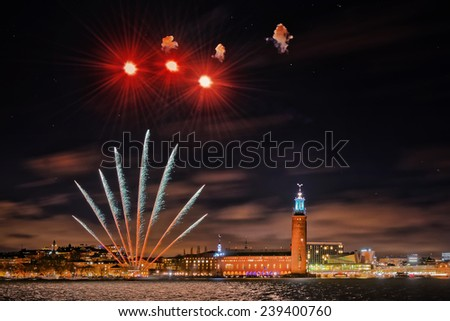 STOCKHOLM, DEC 22: Night photography of the city center with the town hall in Stockholm, clear sky with stars and fireworks. December 2014 in Stockholm, Sweden - stock photo