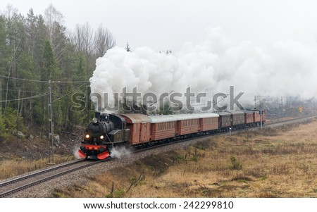 STOCKHOLM, DEC 6: The Steamtrain S1 going in full steam between Stockholm and Nynashamn during Christmas. Stockholm, December 6 in 2014. Delivered to SJ (Statens Jarnvagar) in 1952. - stock photo