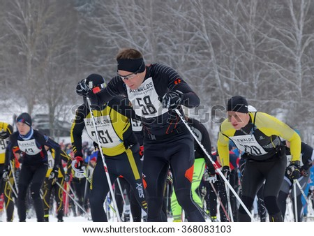 STOCKHOLM - JAN 24, 2016: Group of fighting male cross country skiers after the start at the Stockholm ski marathon event January 24, 2016 in Stockholm, Sweden