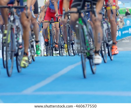 STOCKHOLM - JUL 02, 2016: Closeup of a colorful professional cycle, legs and shoes (only a few in focus) in the Men's ITU World Triathlon series event July 02, 2016 in Stockholm, Sweden