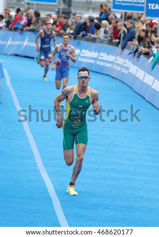 STOCKHOLM - JUL 02, 2016: Running triathlete Jacob Birtwhistle and Simon Vain at the finish in the Men's ITU World Triathlon series event July 02, 2016 in Stockholm, Sweden