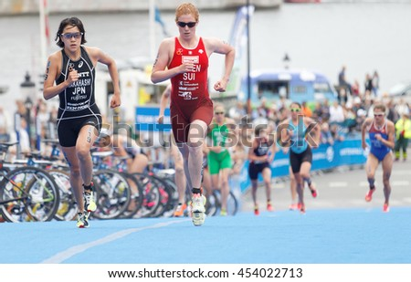 STOCKHOLM - JUL 02, 2016: Takahashi and Annen fighting in the transition zone in the Women's ITU World Triathlon series event July 02, 2016 in Stockholm, Sweden
