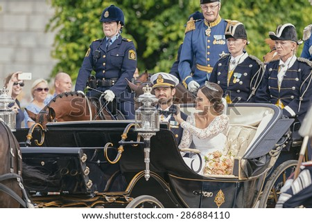 STOCKHOLM - JUN 13, 2015: Royal wedding with Swedish Prince Carl Philip Bernadotte on his way to celebrate the wedding with Princess Sofia (former Hellqvist) - stock photo