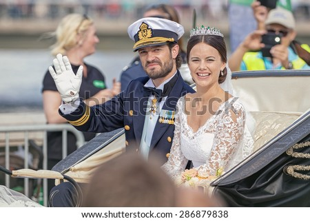 STOCKHOLM - JUN 13, 2015: Royal wedding with Swedish prince Carl Philip Bernadotte waiving to audience on his way to celebrate the act with Princess Sofia (former Hellqvist) - stock photo