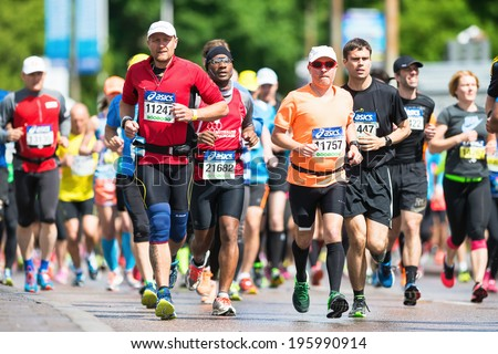 STOCKHOLM - MAY 31: After the start of the second group of ASICS Stockholm Marathon 2014. May 31, 2014 in Stockholm, Sweden. - stock photo