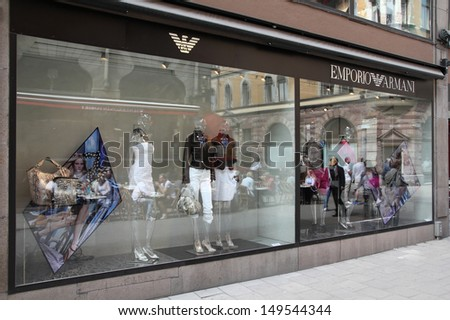 STOCKHOLM - MAY 31: Emporio Armani store on May 31, 2010 in Stockholm. Forbes says that Louis Vouitton was the 8th most powerful luxury brand in the world in 2008 with $5.1bn USD value. - stock photo