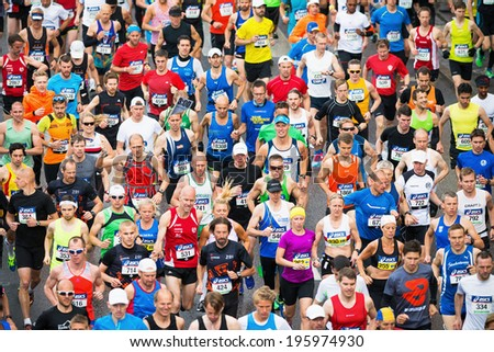 STOCKHOLM - MAY 31: Group of runners after the start of ASICS Stockholm Marathon 2014. May 31, 2014 in Stockholm, Sweden.