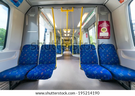 STOCKHOLM - MAY 27: Interior of a Stockholm Metro train. May 27, 2014 in Stockholm, Sweden. The seats decoration is designed of Lasse Aberg with motifs from Stockholm. - stock photo