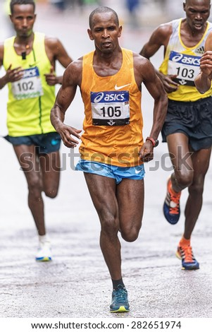 STOCKHOLM - MAY 30: Leading group with Bernard Waweru in front at ASICS Stockholm Marathon 2015. May 30, 2015 in Stockholm, Sweden. The winner Yekeber Bayabel has nr 102. - stock photo