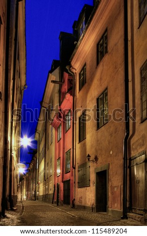 Stockholm Old Town alley at night. - stock photo