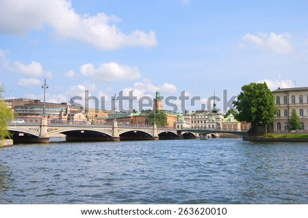 Stockholm, panorama of Parliament House, Norrbro bridge, spire of Riddarholmen Church and City Hall, Sweden - stock photo