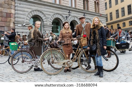 STOCKHOLM - SEPT 19, 2015: Elegant family wearing old fashioned clothes in the Bike in Tweed event September 19, 2015 in Stockholm, Sweden
