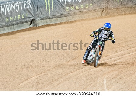 STOCKHOLM - SEPT 25, 2015: Speedway racer in a curve at the TEGERA Stockholm FIM Speedway Grand Prix at Friends Arena in Stockholm. - stock photo