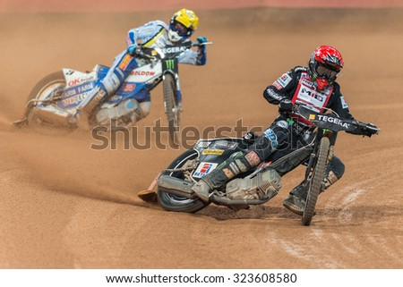 STOCKHOLM - SEPT 26, 2015: Tai Woffinden before Nicki Pedersen in a curve at the TEGERA Stockholm FIM Speedway Grand Prix at Friends Arena in Stockholm. - stock photo