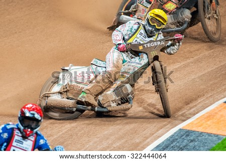 STOCKHOLM - SEPT 26, 2015: Tomas H Jonasson from Sweden between racers in the heat at the TEGERA Stockholm FIM Speedway Grand Prix at Friends Arena in Stockholm.