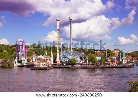 Stockholm, Sweden. Amusement park at famous Djurgarden island, the isle of gardens. Filtered style colors. - stock photo