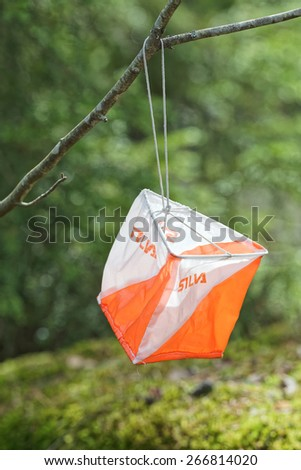 STOCKHOLM, SWEDEN - APRIL 1: Closeup of Orienteering marker in the forest, April 1, 2015 in Stockholm, Sweden. Orienteering is a popular sport in the Nordic countries. - stock photo