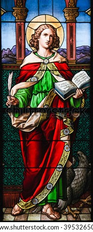 STOCKHOLM, SWEDEN - APRIL 16, 2010: Saint John the Evangelist. Stained glass windowin the German Church in Gamla Stan, Stockholm. - stock photo