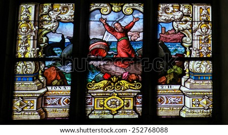 STOCKHOLM, SWEDEN - APRIL 16, 2010:  Stained glass window in Gamla Stan in Stockholm, depicting Jonah and the whale. - stock photo
