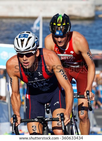 STOCKHOLM, SWEDEN - AUG 23, 2015: Close-up of cycling triathlete Maloy (USA) and Brifford in the Men's ITU World Triathlon series event August 23, 2015 in Stockholm, Sweden