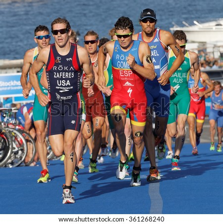 STOCKHOLM, SWEDEN - AUG 23, 2015: Close-up of group of running triathletes including the leader Gomez wearing sun glasses in the Men's ITU World Triathlon series event August 23,2015,Stockholm, Sweden