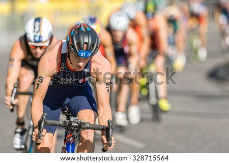STOCKHOLM, SWEDEN - AUG 22, 2015: Closeup of Mathew Sharp from Great Britain leading a peleton at the Men's ITU World Triathlon series event - stock photo