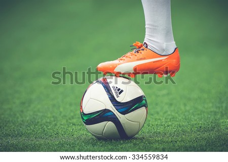 STOCKHOLM, SWEDEN - AUG 24, 2015: Closeup of soccer legs and feet in the game between Djurgarden and Hammarby at Tele2 arena. - stock photo