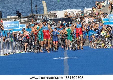 STOCKHOLM, SWEDEN - AUG 23, 2015: Group of triathletes parking the cycles in the transition zone in the Men's ITU World Triathlon series event August 23, 2015 in Stockholm, Sweden