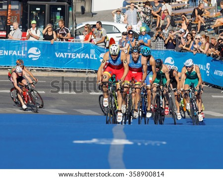 STOCKHOLM, SWEDEN - AUG 23, 2015: Spanish triathletes Gomez, Hernandez and large group of competitors cycling uphill in the Men's ITU World Triathlon series event August 23, 2015 in Stockholm, Sweden - stock photo