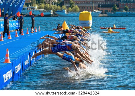 STOCKHOLM, SWEDEN - AUG 22, 2015: Starting grid diving into the water at the Men's ITU World Triathlon series event - stock photo