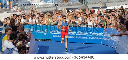 STOCKHOLM, SWEDEN - AUG 23, 2015: Triathlete Javier Gomez Noya a few meters before winning the triathlon event at the Men's ITU World Triathlon series event August 23, 2015 in Stockholm, Sweden