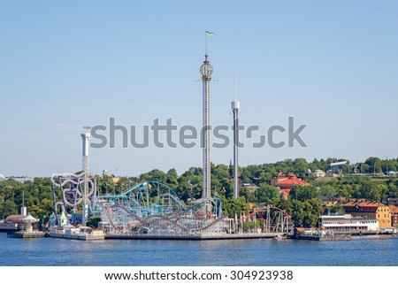 STOCKHOLM, SWEDEN - AUGUST 1, 2015: Amusement park Grona Lund from the seaside during summer. - stock photo