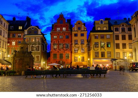 STOCKHOLM, SWEDEN - AUGUST 16, 2014: Old houses and the well on Stortorget square  (Gamla Stan) at night. It`s the most famous point of interest that is visited by thousands of tourists