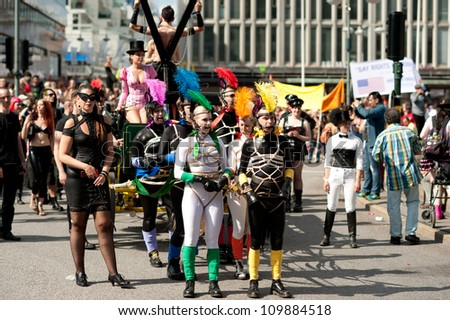 STOCKHOLM, SWEDEN - AUGUST 4: Sadomasochists at Stockholm Pride Parade on August 4, 2012 in Stockholm which attracts an estimated 50000 participants and 500000 spectators. - stock photo