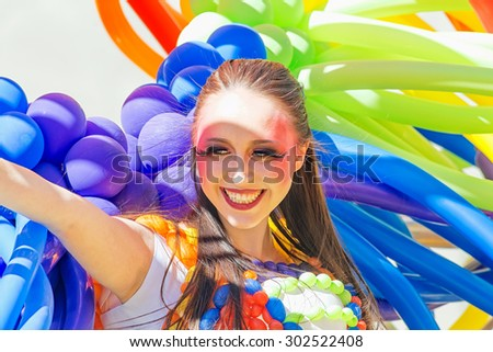 STOCKHOLM, SWEDEN - AUGUST 1, 2015: Smiling girl with colorful baloons at the Pride parade in Stockholm. Approx 400.000 spectators at the streets.