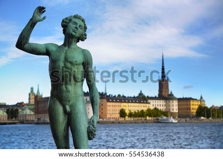 STOCKHOLM, SWEDEN - AUGUST 20, 2016: Song statues near Stockholm City Hall ( Stadshuset ) and View of Gamla Stan from Stockholm City Hall in Stockholm, Sweden on August 20, 2016.