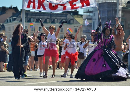 STOCKHOLM, SWEDEN - AUGUST 3: Stockholm Pride Parade 2013 on August 3, 2013 in Stockholm attracts 60000 participants and 600000 spectators. - stock photo
