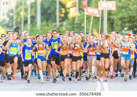 STOCKHOLM, SWEDEN - AUGUST 15, 2015: The starting field just after the start at Lilla Midnattsloppet for aged 14. The track is 1775 meters and the runners are aged 8-15 years. - stock photo