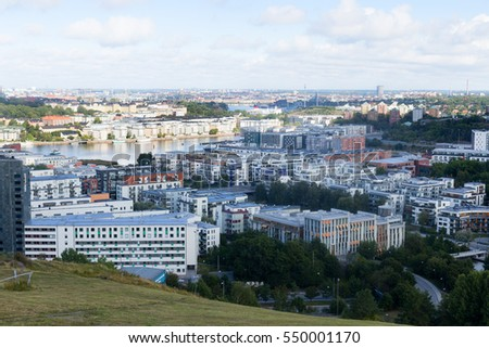 STOCKHOLM, SWEDEN - AUGUST 20, 2016: top view on central living area sodermalm from the hill hammarby backen, modern housing, hotel and water at bright summer day